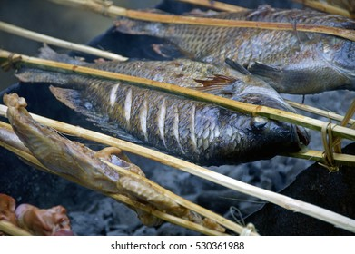 grilled fish on a barbeque on the market Laos