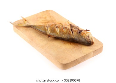 Grilled fish on chopping block isolated on white background
