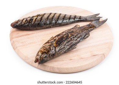 grilled fish on platter. Isolated on a white background.
