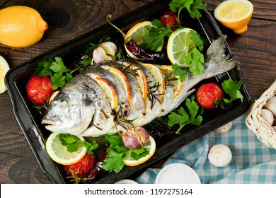 Grilled fish with roasted potatoes and vegetables