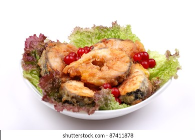 grilled fish with salad and rowan isolated