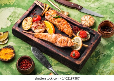 Grilled fish, grilled salmon steak with addition of lemon