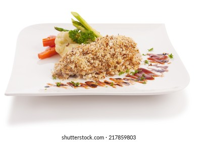 grilled fish sprinkled with breadcrumbs isolated on white.
