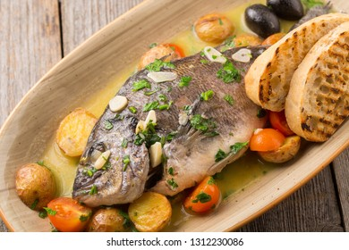 Grilled fish with vegetables and potatoes