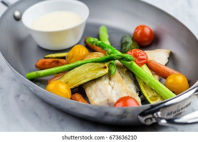 Grilled fish and vegetables with sauce