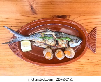 grilled fish with wriklend potatoes