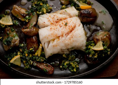 Grilled flounder filet. Classic Italian or French restaurant entree. Seafood grilled w/ olive oil, lemon juice, garlic & onions seasoned with salt and pepper & served w/ spicy chili sauce.