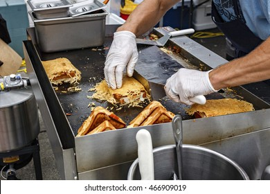Grilled food at an outdoor carnival.