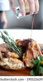 Grilled fried roast Chicken tobacco with pepper sauce on cutting board