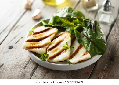 Grilled Greek cheese with green salad