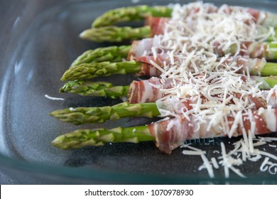 Grilled green asparagus wrapped with bacon and parmesan cheese