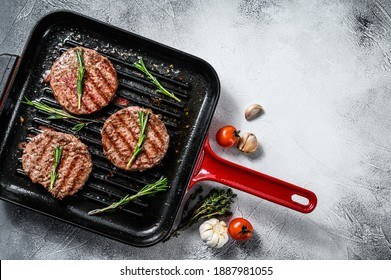 Grilled ground beef patties. Mince meat. White background. Top view. Copy space.