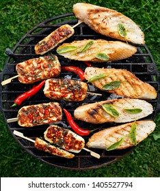 Grilled halloumi cheese with the addition of mint and chilli pepper and  grilled herb toasts from a baguette while grilling outdoors, top view.  Delicious, vegetarian, grilled appetizers