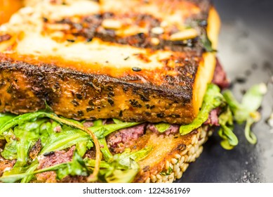 Grilled Halloumi cheese on a piece of toast with rocket lettuce and olive paste