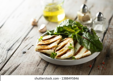 Grilled Halloumi cheese on white plate