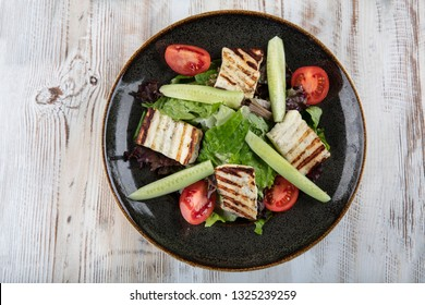 Grilled Halloumi Cheese salad with tomatoes and lettuce. healthy food.