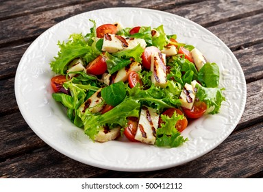 Grilled Halloumi Cheese salad witch tomatoes and lettuce. healthy food