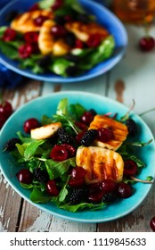 Grilled halumi  cheese salad with berries.food gathering.selective focus