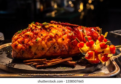 Grilled ham with fruit salad sauce.