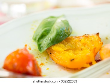 Grilled hokkaido pumpkin and grilled tomato with basil leaf