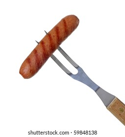 Grilled hot dog on a barbecue fork isolated on white