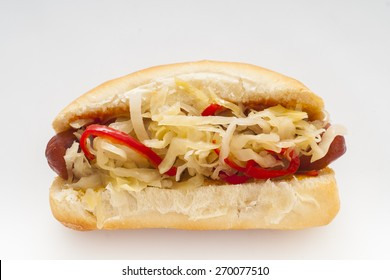 Grilled Hot Dog with sauerkraut and hot red peppers