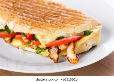 grilled italian panini with chicken, mozzarella cheese and vegetables