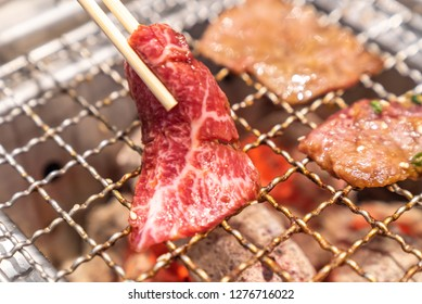 grilled japanese wagyu premium beef yakiniku with red hot charcoal