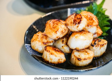 Grilled japaness scallop put on a black plate in Seafood restuarant at sapporo,hokkaido,japan