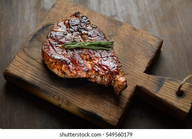 grilled juicy steak with rosemary. top view