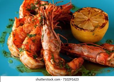 Grilled jumbo shrimps (head on) with lemon and garlic and citrus sauce