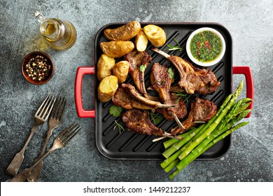 Grilled lamb chops with green herb sauce, asparagus and potatoes