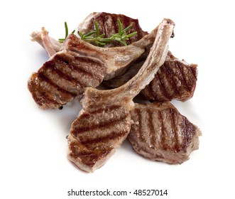 Grilled lamb cutlets with a sprig of rosemary.
