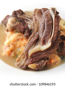 Grilled lamb on mashed potatoes served on plate