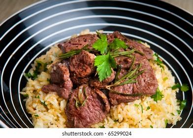 Grilled lamb on saffron rice