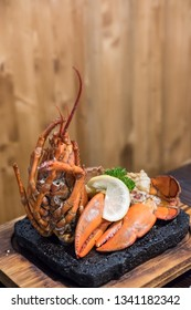 Grilled Lobster with lemon served on plate.