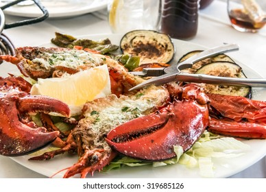 Grilled lobster on the sliced vegetables with cracker
