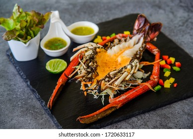 Grilled Lobster and seafood souce on plate.