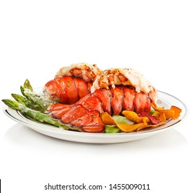 Grilled Lobster Tails Served With Asparagus on white background