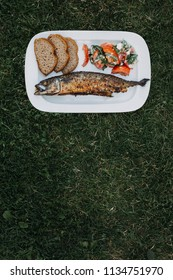 Grilled mackerel with 100% rie bread slices and tomato salad with feta cheese and organic basil leaves
