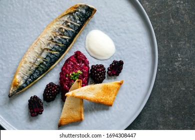 Grilled mackerel with beetroot and pickled blackberies