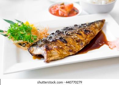 grilled mackerel(Saba) steak with teriyaki sauce and rice on white dish, popular japanese cuisine