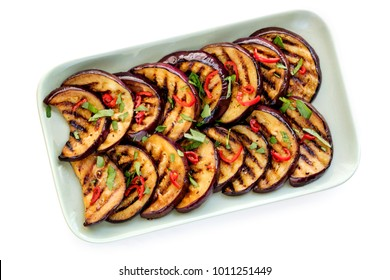 Grilled marinated eggplant slices isolated on white, top view.
