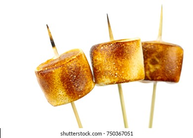 Grilled marshmallows on sticks