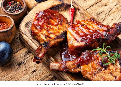 Grilled meat. Grilled meat with autumn plum.Bbq