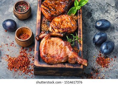 Grilled meat with autumn plum. Bbq Pork rack grilled