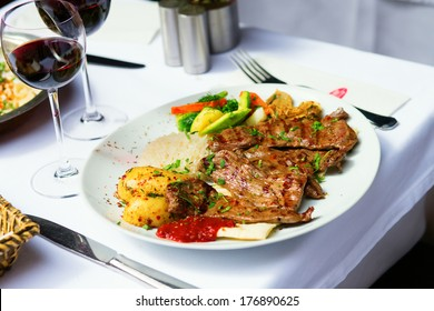 Grilled meat and baked vegetables in a Turkish restaurant