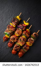 Grilled meat kebab on barbecue