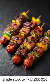 Grilled meat kebab with vegetables