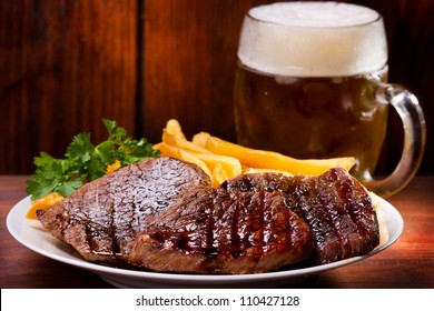 grilled meat and mug of beer